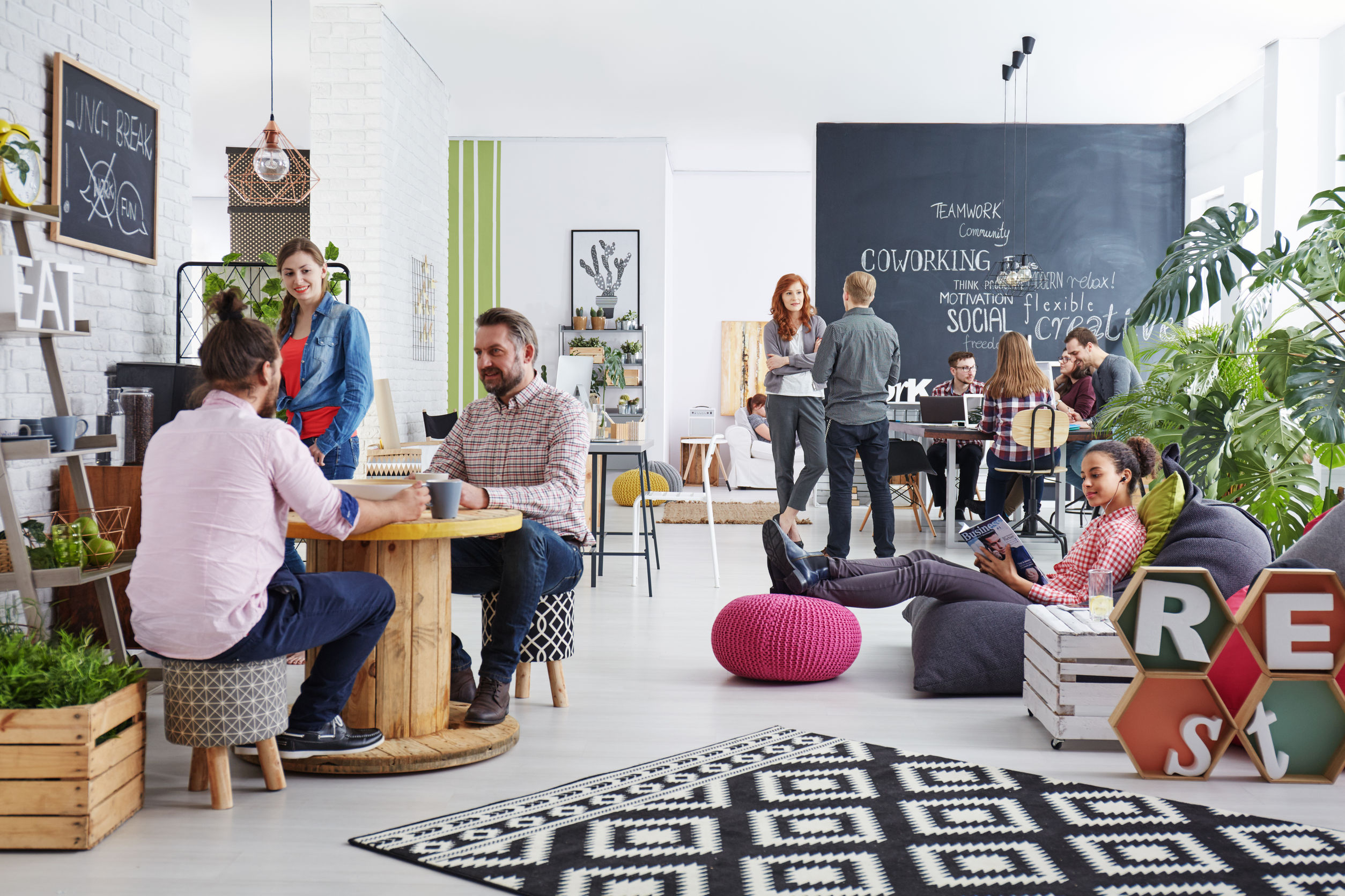 people working in modern agency relaxing during lunch break - modern office